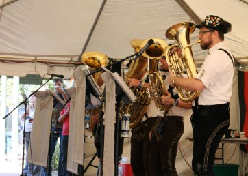 The Tuba Meisters band performs their renditions of several famous German songs. Band leader Ray Grim (far right) sings between blowing notes on the Tuba.