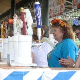 Volunteers at the festival prepare to refill cups at the bar taps. Floral crowns adorned the heads of many women at the festival.