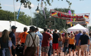 With an estimated 18,000 visitors in one weekend, the line for Fredericksburg's Oktoberfest grows rapidly. Some visitors arrive in traditional German costume.