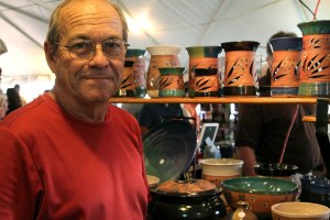 Ron Kuykendall displays his homemade pottery in the vendor's tent. This was Kuykendall's second year to sell at Oktoberfest.